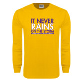 Gold Long Sleeve T Shirt-It Never Rains On The Storm