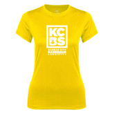 Ladies Syntrel Performance Gold Tee-Kansas City Barbeque Society