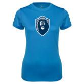 Ladies Syntrel Performance Light Blue Tee-Lion Shield
