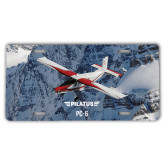 License Plate-PC-6 Over Snowy Cliff