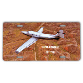 License Plate-PC-12 NG Over Brown Fold Mtns